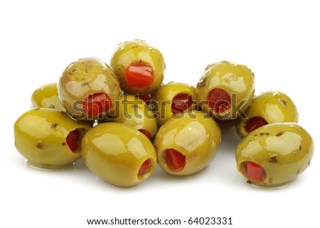 bunch of stuffed green olives on a white background - stock photo