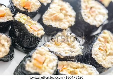 Bunch of sushi rolls. Shallow dof. - stock photo