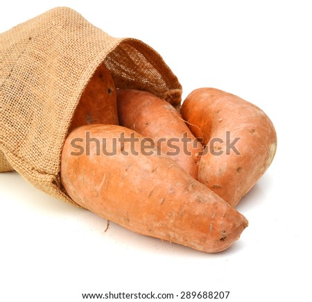 Bunch of sweet potatoes in burlap on a white background