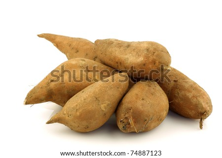 bunch of sweet potatoes on a white background