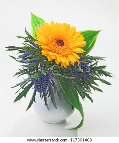bunch of the flowers arranged in the vase isolated in white - stock photo