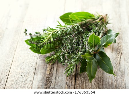 bunch of various herbs on wooden table