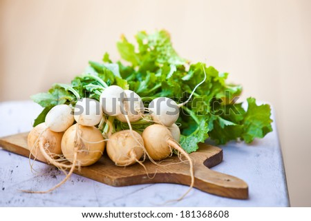 Bunch of white and yellow turnip with leaves. Also available in vertical format.  - stock photo