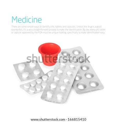 Bunch of white medicine pills on white background - stock photo