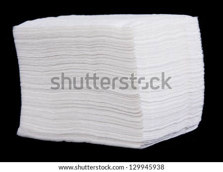 Bunch of white paper napkins on black background