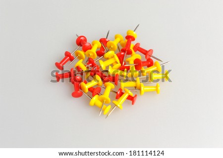 Bunch of yellow and red office buttons on gray background - stock photo
