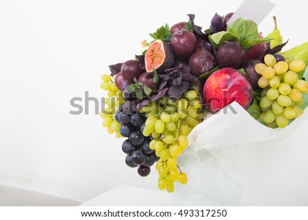 Bunches of grapes closeup. The concept of alternative flower bouquets, Edible bouquet of fruits and berries.