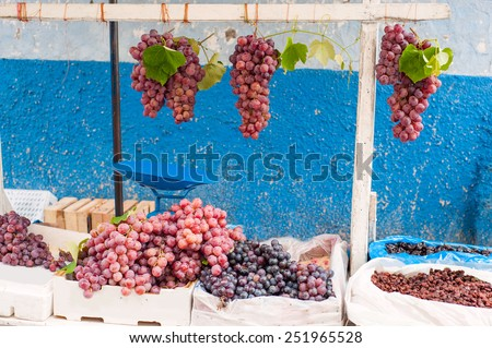 Bunches of grapes on the market - stock photo