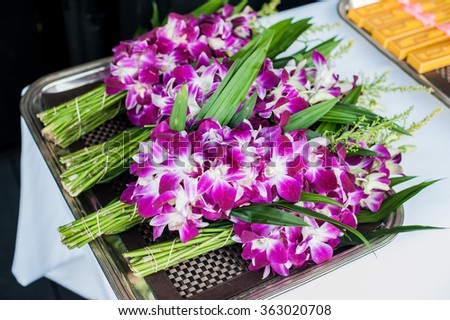 Bunches of Orchid Flowers in Stainless steel tray for Worship the Monk in Thai Style - stock photo