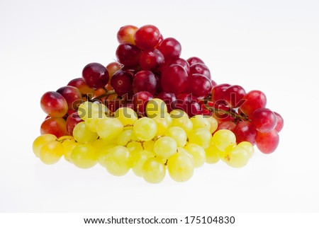 bunches  of red and green grapes isolated on white background - stock photo