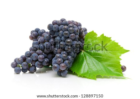 bunches of ripe grapes and green grape leaf on a white background close-up - stock photo