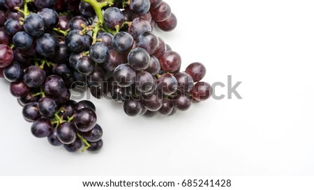 Bunches of ripe grapes on a white background.