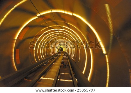 Bund Tourist Tunnel Shanghai is  a sightseeing tunnel under the Huangpu river. The tunnel stretches over an area of 646.7 meter, it is the first cross-river artificial sightseeing tunnel of China.