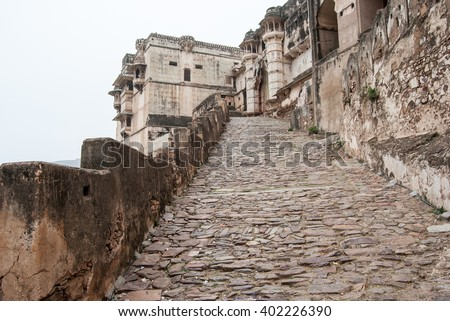 Bundi, Rajasthan, India. The narrow cobblestone path leading to the City Palace - stock photo