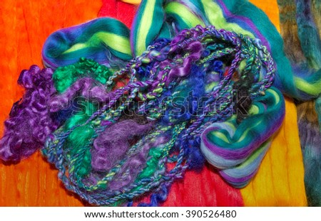 Bundle of brightly colored plaited woven wool fibers