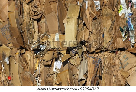 Bundle of cardboard at recycling centre - stock photo