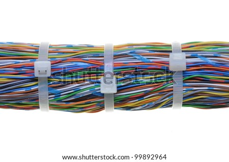 Bundle of color cables with white cable ties - stock photo