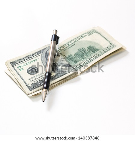 Bundle of 100 dollar with pen isolated on a white background