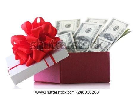 Bundle of dollars in present box with bow isolated on white - stock photo