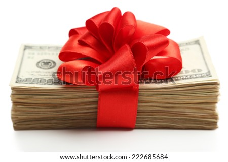 Bundle of dollars tied with ribbon isolated on white - stock photo