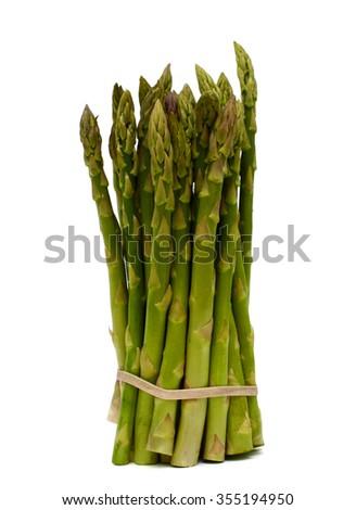 bundle of fresh green asparagus isolated on white background  - stock photo