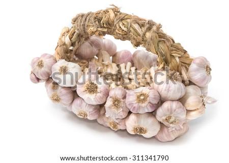 Bundle of garlic isolated on white background - stock photo
