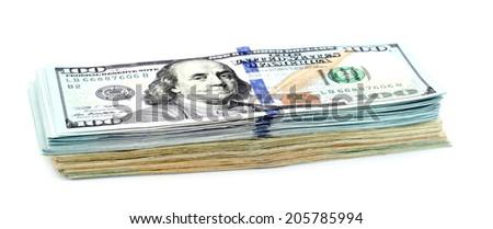 bundle of money isolated on white background - stock photo