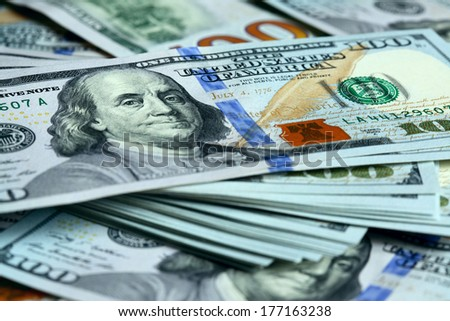 Bundle of new hundred dollar bills - stock photo