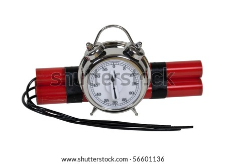 Bundle of red sticks of dynamite with long fuses with a timer alarm clock bomb that is only moments before zero - path included - stock photo