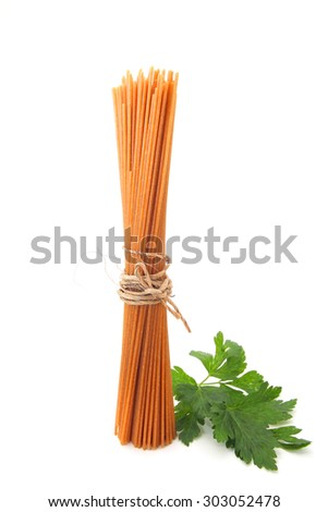 Bundle of uncooked wholegrain spaghetti isolated on white background - stock photo
