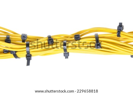 Bundle of yellow cables with white cable ties  - stock photo
