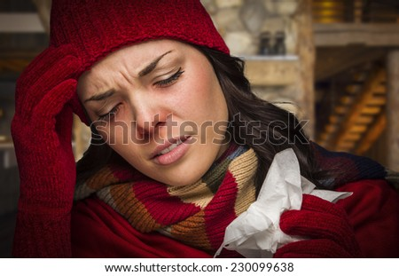 Bundled Up Sick Woman Inside Cabin With Tissue. - stock photo