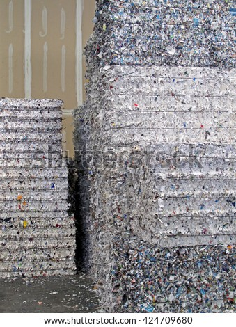 Bundles of shredded paper, stacked and bound for recycling