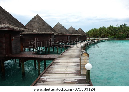 Bungalow and timber pier at island resort Maldives, Asia, Indian Ocean