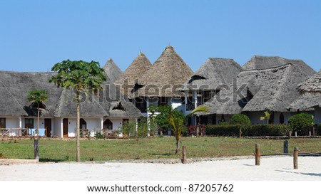 Bungalow resort in Zanzibar on a sunny day - stock photo
