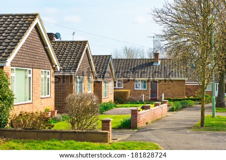 Bungalows in a suburban UK neighbourhood in spring - stock photo