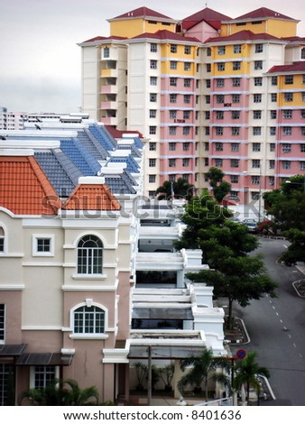 Bungalows in row, against colorful apartment: Living in Asia - stock photo