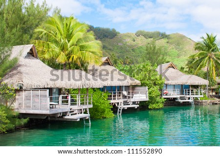 Bungalows in Tahiti. Over turquoise pacific ocean - stock photo