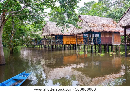 Bungalows in the Amazon rain forest in a flooded area on stilts near Iquitos, Peru - stock photo