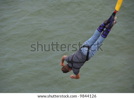 Bungee Jumper at sea - stock photo