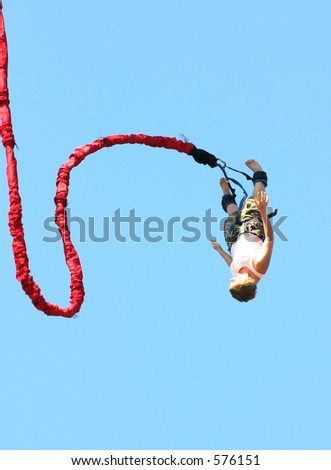 Bungee Jumper with a curved bungie cord. - stock photo