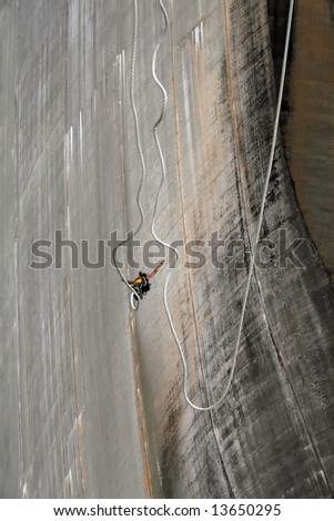 Bungee jumping from the Verzasca dam - stock photo