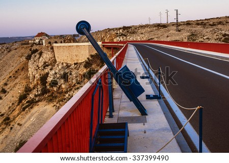 Bungee jumping on Maslenica Bridge is a deck arch bridge carrying the D8 state road approximately 1 km to the west of the settlement of Maslenica, Croatia - stock photo