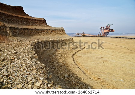 Bunk wall excavated pit mine. Mining giant excavator. - stock photo
