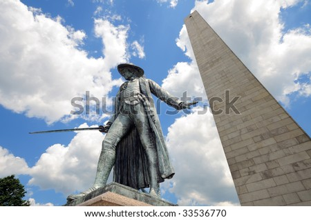 Bunker Hill Monument in Boston, Massachusetts. Granite obelisk and bronze statue of Colonel William Prescott, who commanded the patriot forces here on the first major battle of the American Revolution