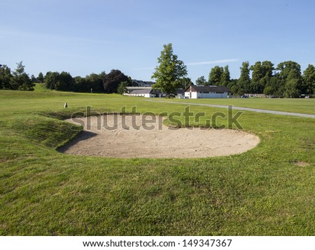 bunker on a golf course in the summer time