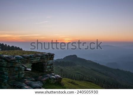 bunker on border hill ,Doi Chang Mub at sunset twilight Chiangrai ,Thailand. - stock photo