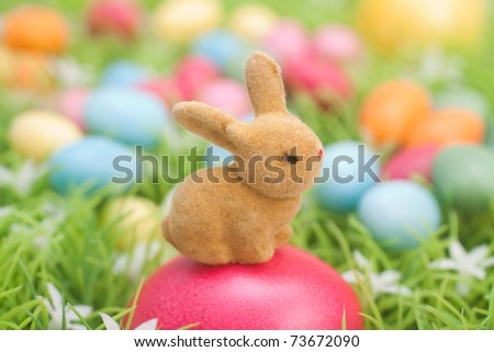 bunny guarded easter eggs - stock photo