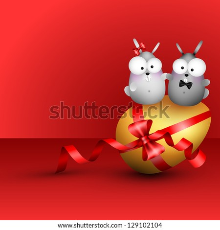 Bunny with easter egg. - stock photo
