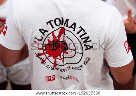 Bunol, Spain - August 28: A man in a T-shirt with  logo on Tomatina festival in Bunol, August 28, 2013 in Spain - stock photo